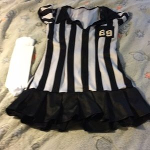 Referee adult costume with number 69 on it.